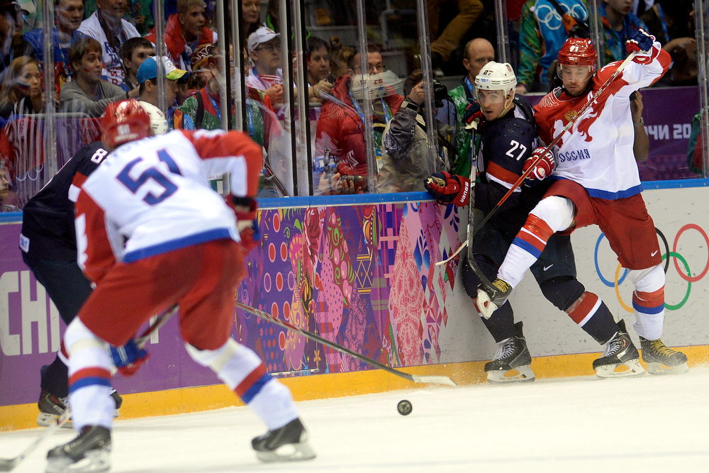 . Ilya Kovalchuk (71) of the Russia and RyanMcDonagh (27) of the U.S.A. collide during  the third period of the U.S.A.\'s shootout-win at Bolshoy arena. Sochi 2014 Winter Olympics on Saturday, February 15, 2014. (Photo by AAron Ontiveroz/The Denver Post)