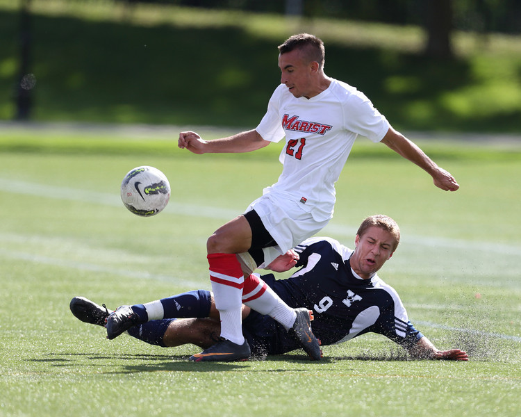 POUGHKEEPSIE, NY - SEPTEMBER 23: Dylan Lee #21 voids attempted steal from Peter Jacobson #9 during Yale verses Marist Soccer on September 23, 2012 at Tenney Stadium in Poughkeepsie New York.  Yale defeats Marist 2-1. (Photo by Sandy Tambone)