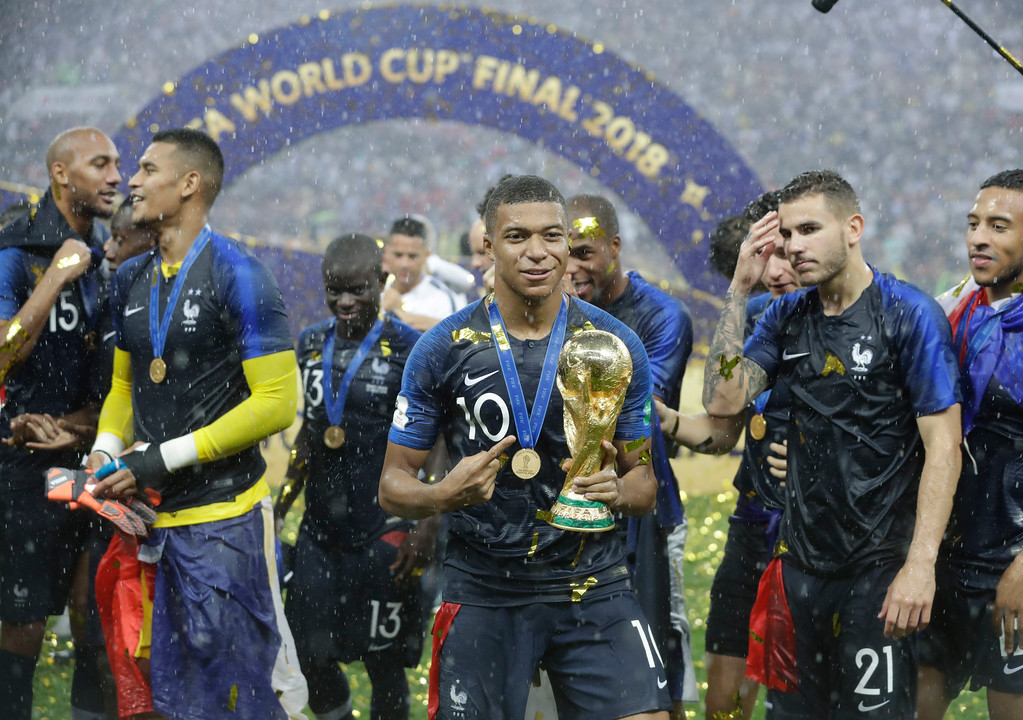 . France\'s Kylian Mbappe celebrates with the trophy after the final match between France and Croatia at the 2018 soccer World Cup in the Luzhniki Stadium in Moscow, Russia, Sunday, July 15, 2018. France won the final 4-2. (AP Photo/Matthias Schrader)