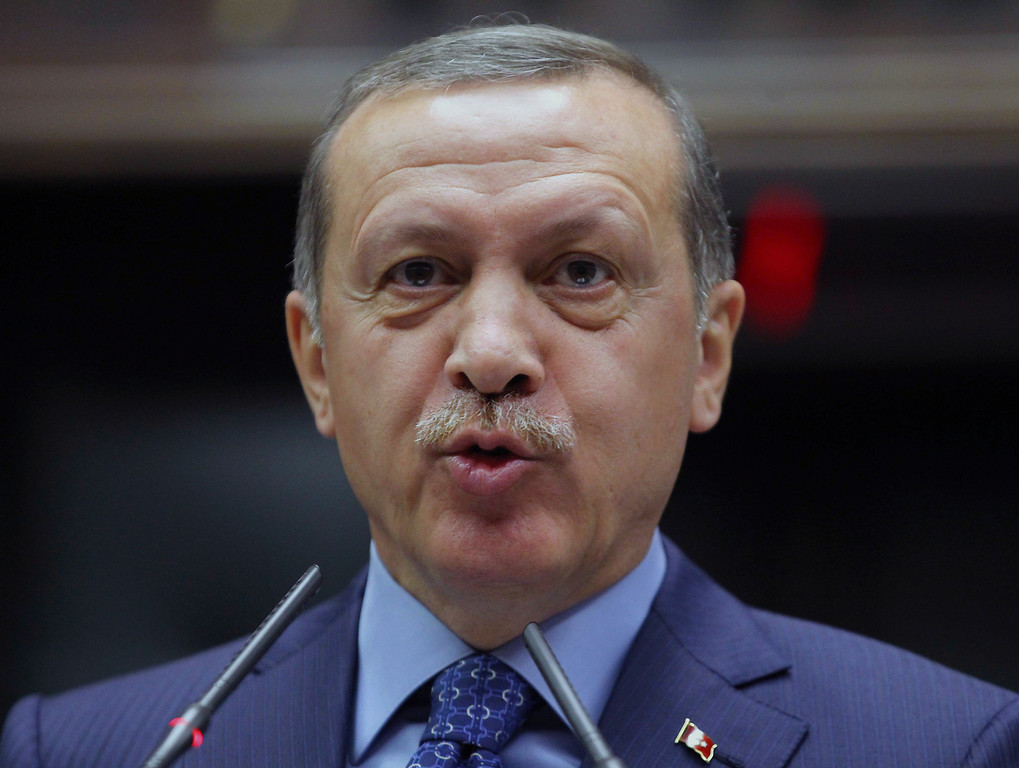 ". Turkey\'s Prime Minister Recep Tayyip Erdogan addresses party members in Parliament in Ankara, Turkey, Tuesday, May 7, 2013. Edogan has denounced Israeli airstrikes on Syria, saying the attacks help strengthen Syrian President Bashar Assad\'s hand. Erdogan also criticized Iran for ""turning a blind eye\"" to massacres in Syria and accused the international community of ignoring the bloodshed. (AP Photo)"