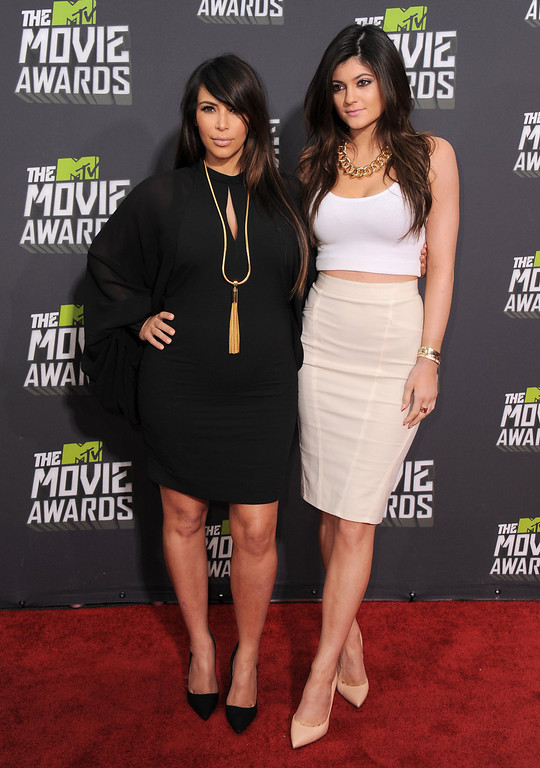 . Kim Kardashian, left, and Kylie Jenner arrive at the MTV Movie Awards in Sony Pictures Studio Lot in Culver City, Calif., on Sunday April 14, 2013. (Photo by Jordan Strauss/Invision/AP)