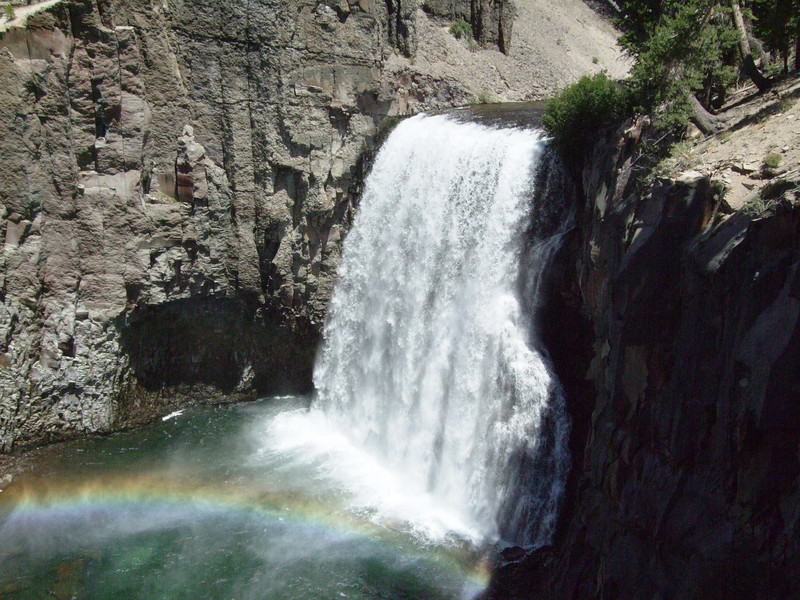 The Middle Fork of the San Joaquin River plunges 101 feet over a cliff of volcanic rock forming Rainbow Fall (2.255m or 7,398ft).