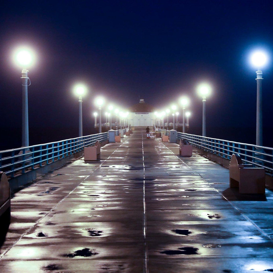 The Manhattan Beach Pier, early morning, following a rain, with the lights still on,