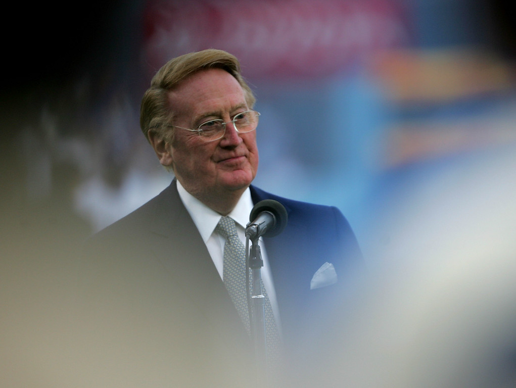 . Hall of Fame broadcaster Vin Scully speaks during ceremonies honoring Jackie Robinson before the game between the San Diego Padres and the Los Angeles Dodgers on April 15, 2007 at Dodger Stadiium in Los Angeles, California.    (Photo by Stephen Dunn/Getty Images)