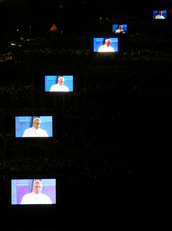 . Pope Francis is projected on screens at Copacabana beach in Rio de Janeiro, July 25, 2013. Pope Francis is on the fourth day of his week-long visit for World Youth Day.  REUTERS/Paulo Whitaker