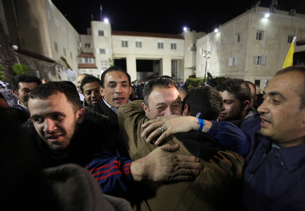 . Freed Palestinian prisoners are greeted as they arrive at the Mukata Presidential Compound in the early hours on December 31, 2013 in Ramallah, West Bank.  Israel freed 26 Palestinian prisoners under peace talks brokered by US Secretary of State John Kerry, who returns to the region this week to boost the faltering negotiations.   ABBAS MOMANI/AFP/Getty Images