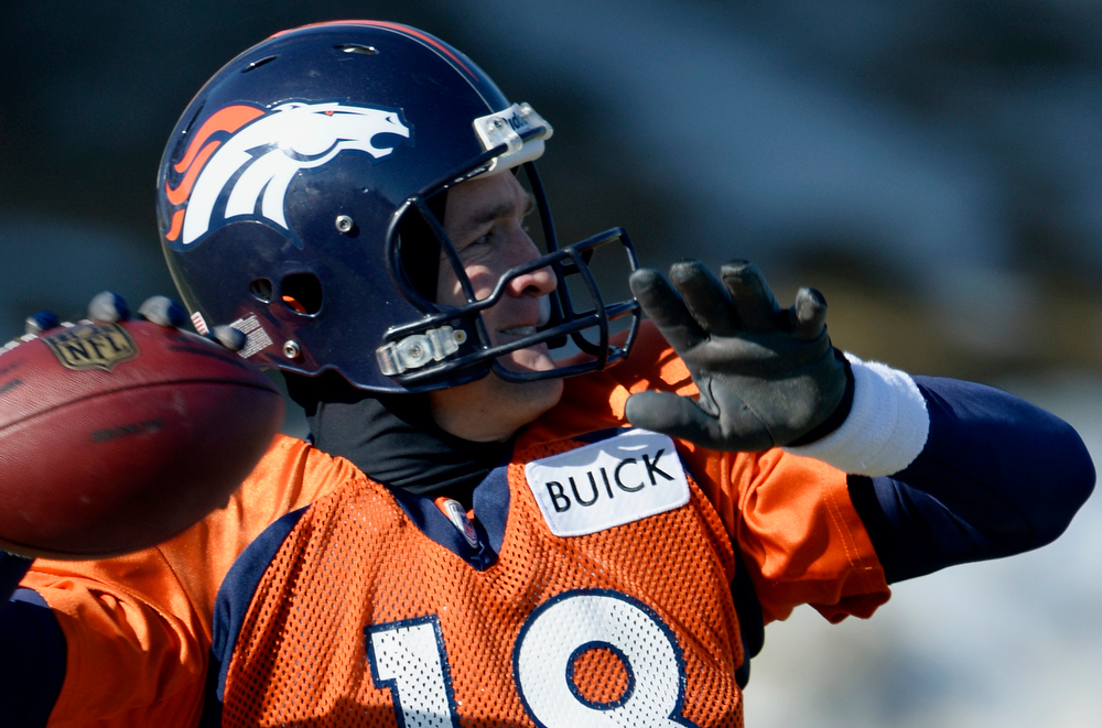 . Denver Broncos quarterback Peyton Manning (18) looks to throw down field during practice January 8, 2014 at Dove Valley. The Denver Broncos are preparing for their Divisional Game against the San Diego Chargers at Sports Authority Field. (Photo by John Leyba/The Denver Post)