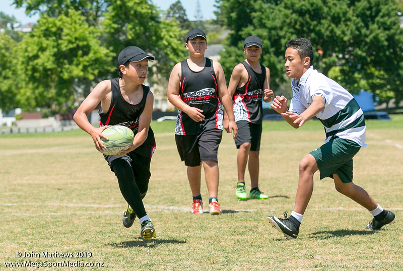 Images of the game between Dilwood (green) and Stanhope Road (black) at the Eastern Zone Touch Tournament for boys, girls and mixed grades held at Madills Farm, Kohimarama, Auckland on 5 November 2019. Copyright: John Mathews 2019.   www.megasportmedia.co.nz