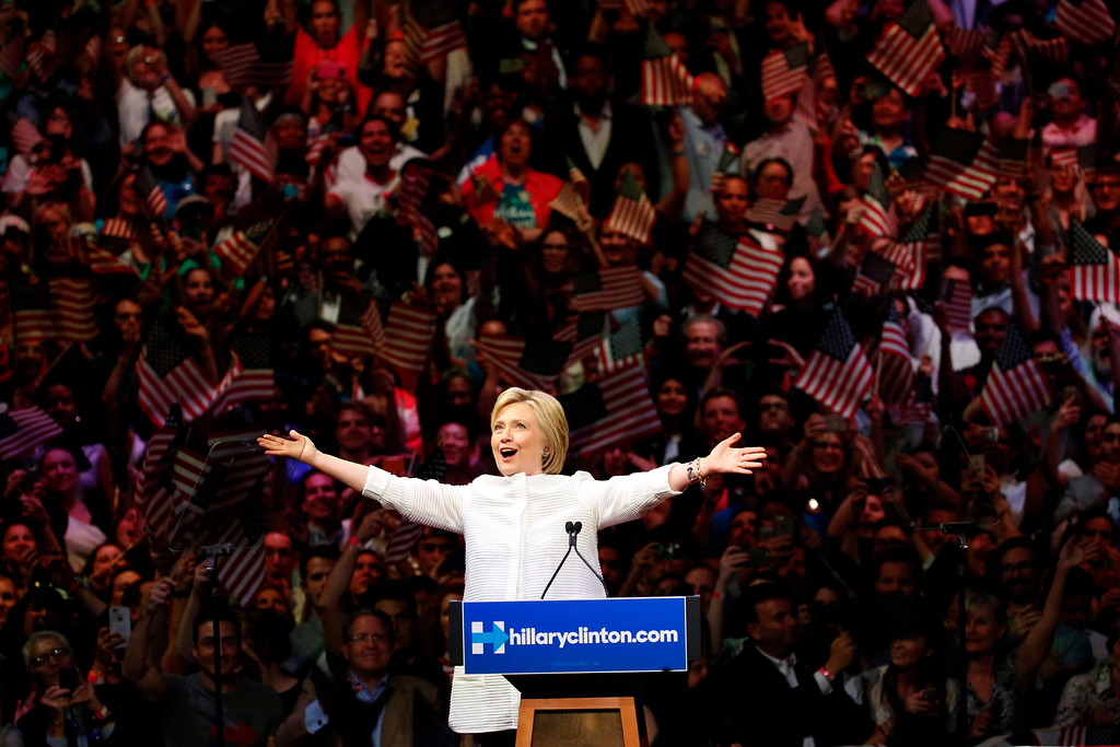 """. Democratic presidential candidate Hillary Clinton speaks during a presidential primary election night rally, Tuesday, June 7, 2016, in New York. Hillary Clinton hailed a historical \""""milestone\"""" for women as she claimed victory over rival Bernie Sanders in the Democratic White House nomination race. \""""Thanks to you, we\'ve reached a milestone,\"""" she told cheering supporters at a rally in New York. \""""The first time in our nation\'s history that a woman will be a major party\'s nominee.\"""" (AP Photo/Julio Cortez)"""