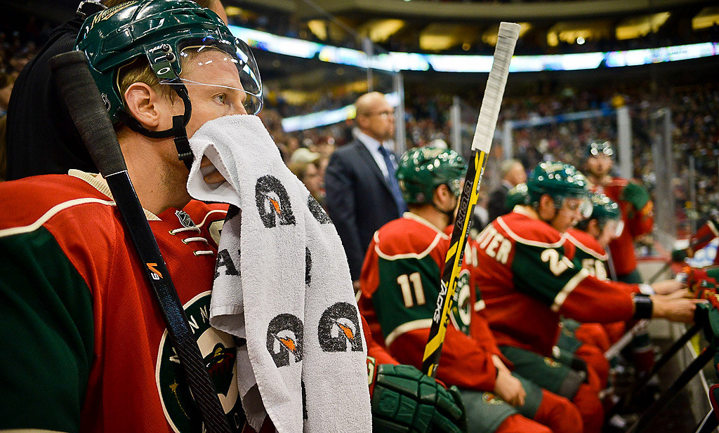 . Minnesota Wild center Mikko Koivu wipes sweat off his face in the first period. (Pioneer Press: Ben Garvin)