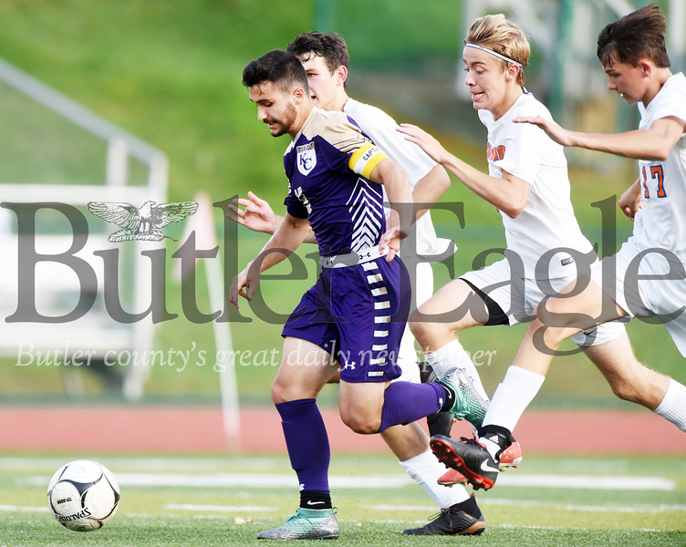 Harold Aughton/Butler Eagle: Karns City's Nathan Rondinelli brings the ball down the field in front of a host of Armstrong defenders. Karns City beat Armstrong 6 - 3, Mon. Sept. 30.