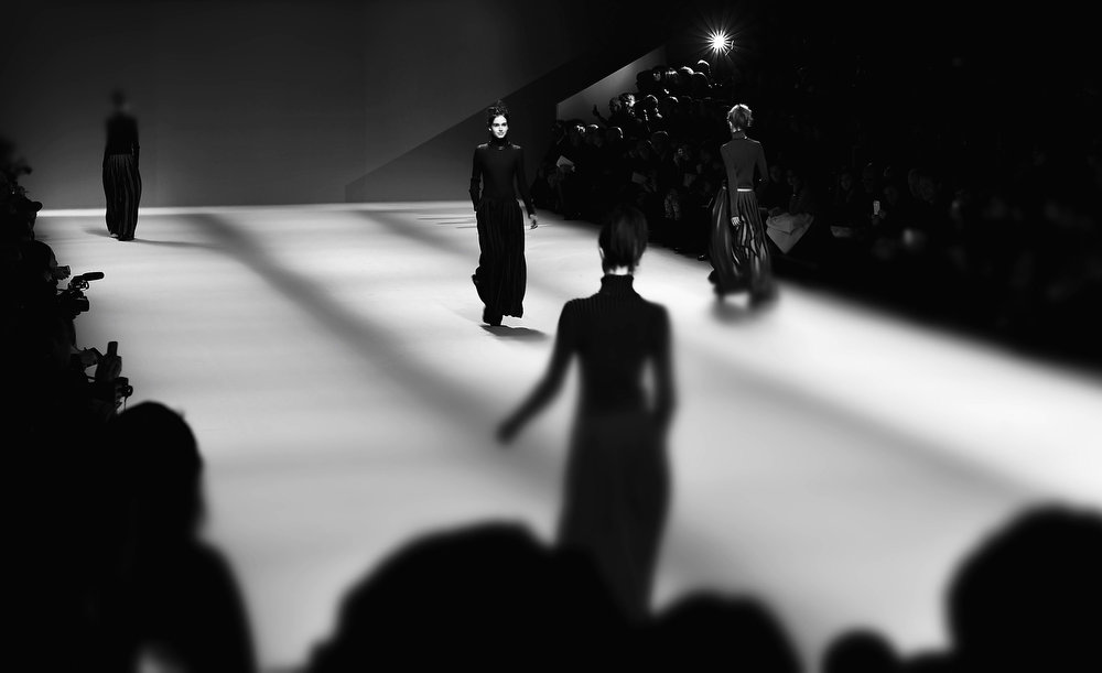 Description of . Models walk the runway during the Issey Miyake Fall/Winter 2013 Ready-to-Wear show as part of Paris Fashion Week on March 1, 2013 in Paris, France.  (Photo by Gareth Cattermole/Getty Images)