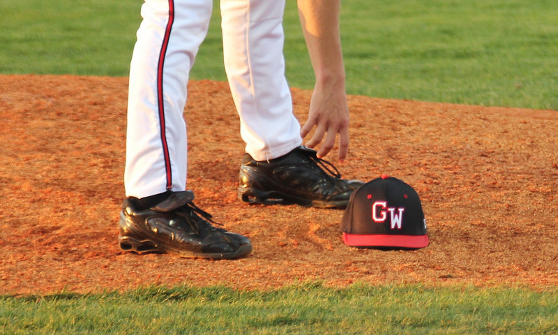 A shot of the notorious GW hat as pitcher Brandon Boling gathers it from the dirt of the mound on March 18th, 2011.