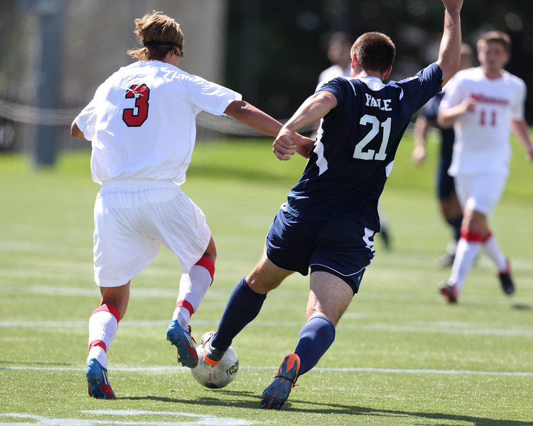 POUGHKEEPSIE, NY - SEPTEMBER 23: Simon Laugsand #3 and Yale Bulldogs Milan Tica #21 battle for ball at Yale verses Marist Soccer on September 23, 2012 at Tenney Stadium in Poughkeepsie New York.  Yale defeats Marist 2-1. (Photo by Sandy Tambone)