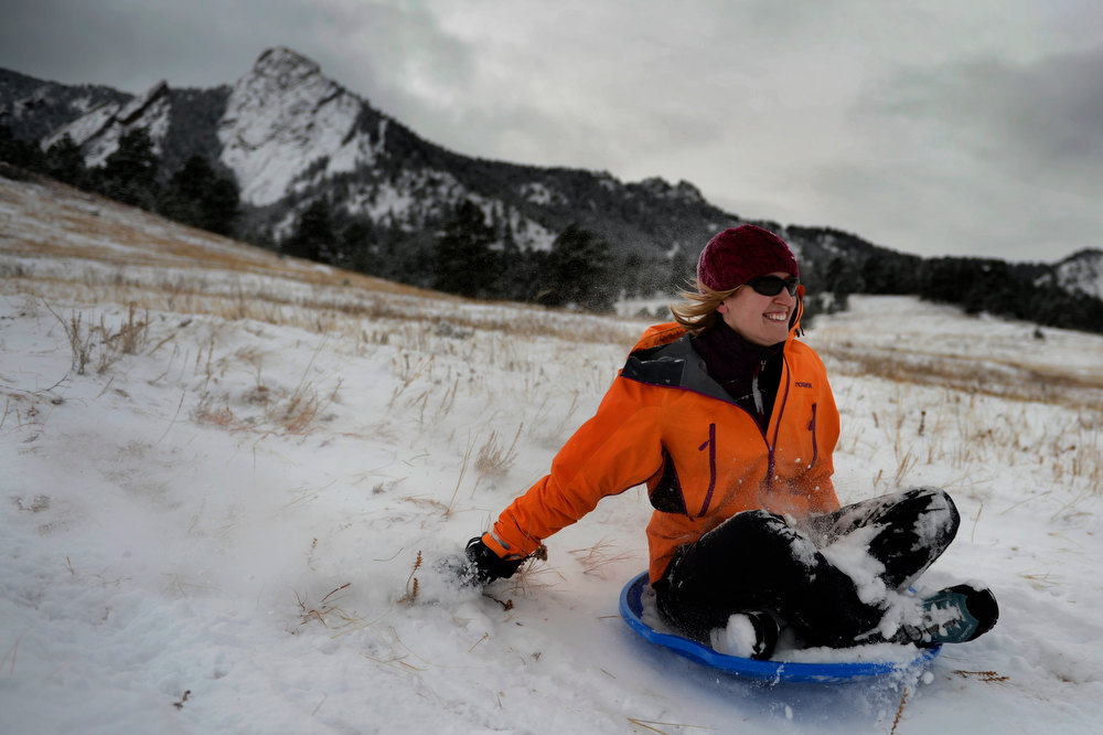 . Renee Farrar a 28 year old CU student that lives in Boulder sliding down the hill in front of the slabs at Chautauqua Park in Boulder Colorado, Wednesday, December 19,  2012.    Joe Amon, The Denver Post