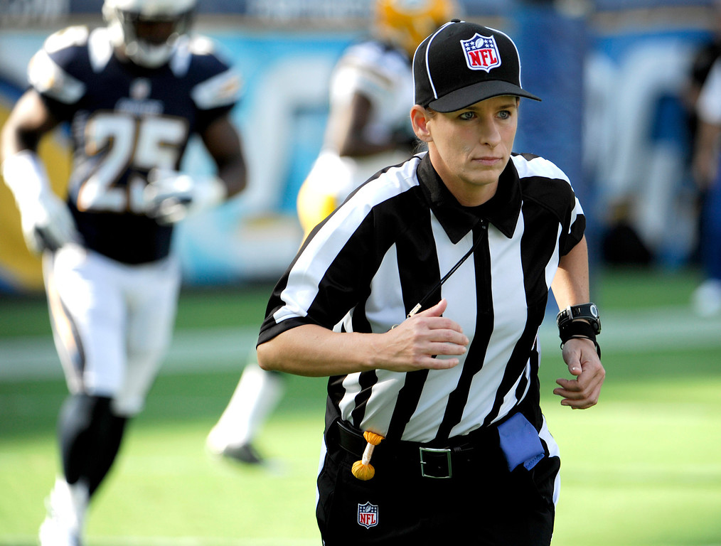 . In this Aug. 9, 2012 file photo, Line judge Shannon Eastin takes the field during an NFL preseason football game between the San Diego Chargers and the Green Bay Packers in San Diego. Eastin was a replacement official making her NFL debut in the exhibition game. The regular officials had been locked out by the league after their contract expired. (AP Photo/Denis Poroy, File)
