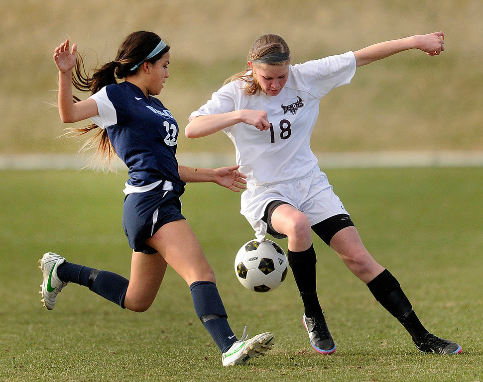 . PARKER, CO. - APRIL 2: Golden defender Jordan Larimore (18) tried to stop Valor midfielder Amanda Lopez (22) in the first half. The Valor Christian High School girl\'s soccer team defeated Golden 4-1 Wednesday night, April 3, 2013.  Photo By Karl Gehring/The Denver Post)
