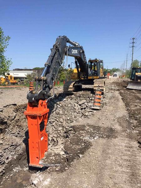 NPK GH23 hydraulic hammer on Deere excavator - Ottawa  May 2018 (1).jpg