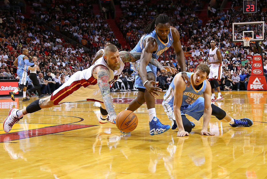 . MIAMI, FL - MARCH 14:  Chris Andersen #11 of the Miami Heat, Timofey Mozgov #25 and Kenneth Faried #35 of the Denver Nuggets scramble for a loose ball during a game  at American Airlines Arena on March 14, 2014 in Miami, Florida. (Photo by Mike Ehrmann/Getty Images)