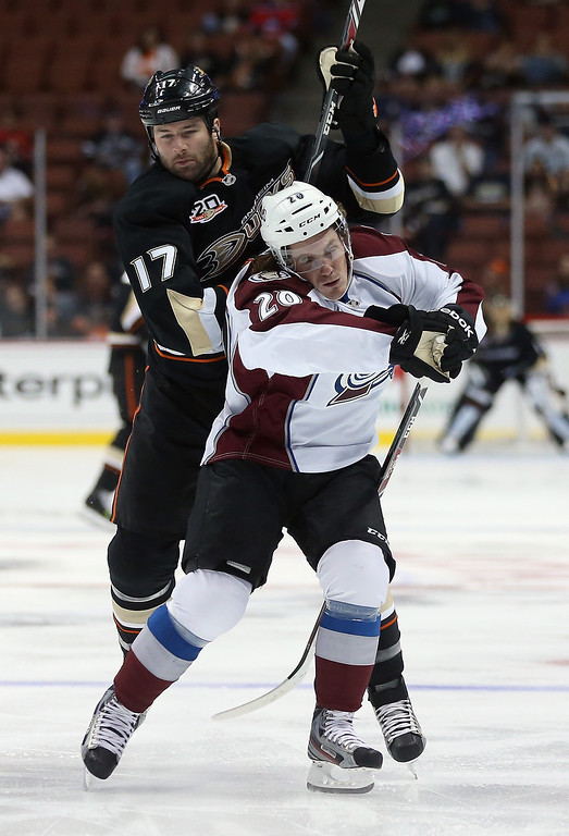 . Dustin Penner #17 of the Anaheim Ducks hits Bryan Lerg #20 of the Colorado Avalanche in the first period at Honda Center on September 22, 2013 in Anaheim, California.  (Photo by Jeff Gross/Getty Images)