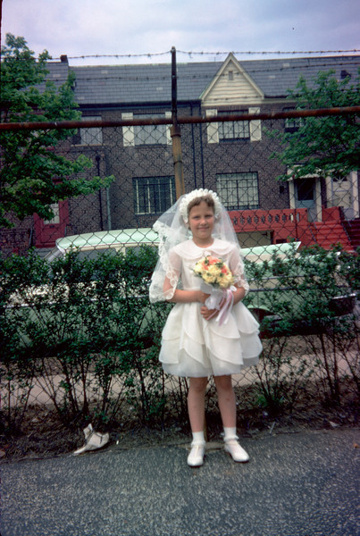 susan with communion dress in parking lot.jpg