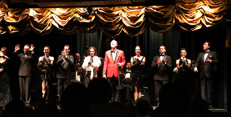 Tango performers bow for appaluse.