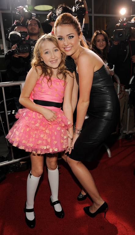 """. Miley Cyrus, right, star of \""""The Last Song,\"""" poses with her sister Noah Cyrus on the red carpet at the premiere of the film in Los Angeles, Thursday, March 25, 2010. (AP Photo/Chris Pizzello)"""