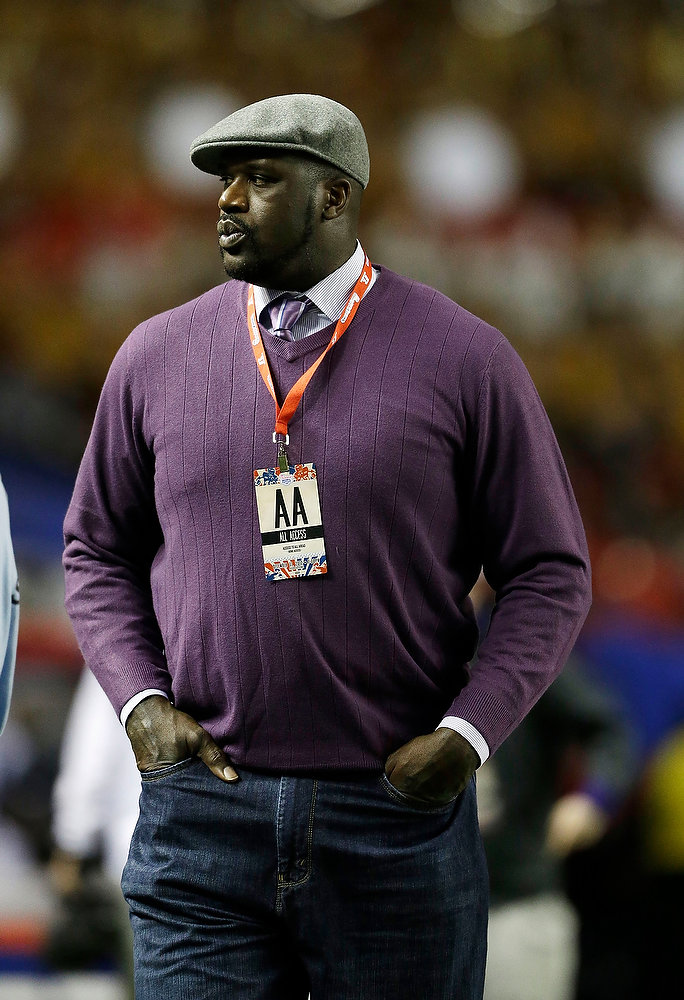 Description of . Former LSU and NBA basketball player Shaquille O'Neal walks the field before the Chick-fil-A Bowl NCAA college football game between Clemson and LSU, Monday, Dec. 31, 2012, in Atlanta. (AP Photo/David Goldman)