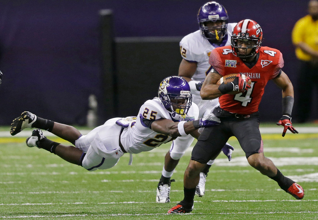 . Louisiana-Lafayette wide receiver Javone Lawson (4) is chased by East Carolina defensive back Leonard Paulk (25) and linebacker Gabriel Woullard (42) in the first half of the New Orleans Bowl, an NCAA college football game in New Orleans, Saturday, Dec. 22, 2012. (AP Photo/Bill Haber)