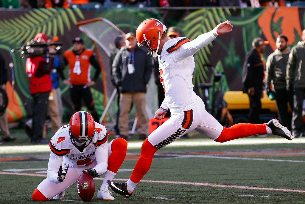 . Cleveland Browns kicker Zane Gonzalez (5) kicks a field goal alongside punter Britton Colquitt (4) in the first half of an NFL football game against the Cincinnati Bengals, Sunday, Nov. 26, 2017, in Cincinnati. (AP Photo/Gary Landers)