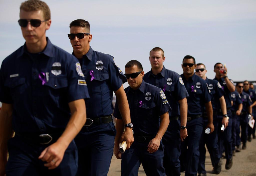 . Members of the Ventura County Fire Crew from California attend a memorial for the Prescott Fire Department\'s Granite Mountain Interagency Hot Shot Crew in Prescott Valley, Arizona July 9, 2013.  REUTERS/Joshua Lott
