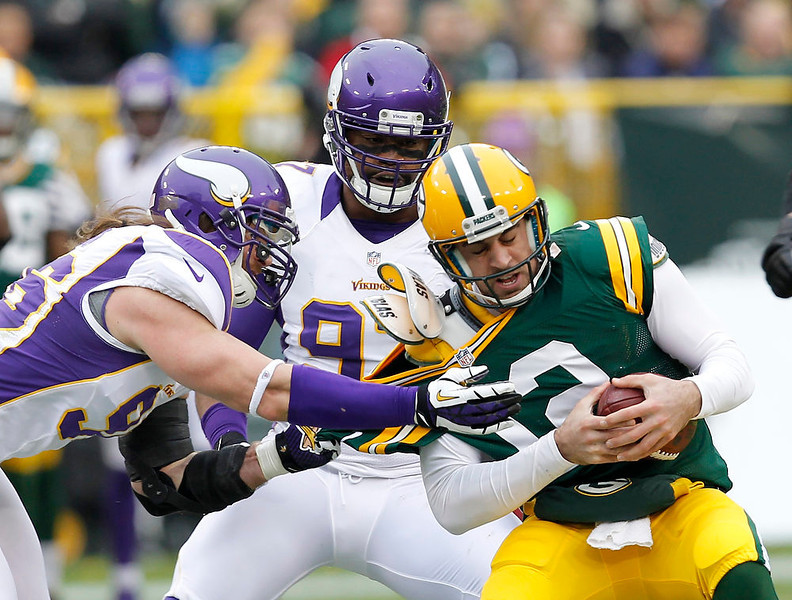 . Minnesota Vikings\' Brian Robison (96) and Everson Griffen sack Green Bay Packers quarterback Aaron Rodgers (12) during the first half of an NFL football game Sunday, Dec. 2, 2012, in Green Bay, Wis. (AP Photo/Mike Roemer)