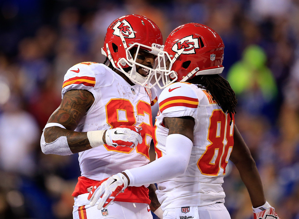 . INDIANAPOLIS, IN - JANUARY 04:  Wide receiver Dwayne Bowe #82 celebrates with wide receiver Junior Hemingway #88 of the Kansas City Chiefs against the Indianapolis Colts during a Wild Card Playoff game at Lucas Oil Stadium on January 4, 2014 in Indianapolis, Indiana.  (Photo by Rob Carr/Getty Images)