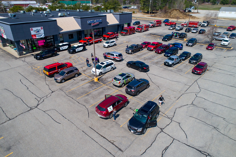 Cars and trucks gather in the Daddy-O's parking lot before the parade.