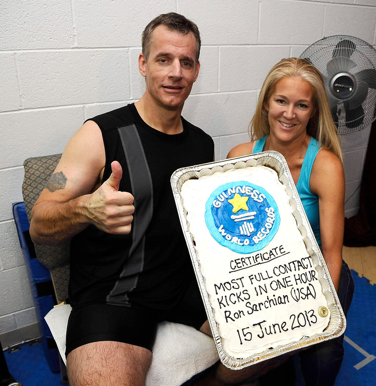 . Actor/stuntman Ron Sarchian and Diane Klein pose together with a cake as Ron set a new Guinness world record by full contact kicking a bag 6,000 times in one hour and did it by 6,012 at the Martial Arts History Museum in Burbank.  The last record for this was set in 2007 and Ron Sarchian  now hold\'s 6 guinness world records Photo by Gene Blevins/LA Daily News