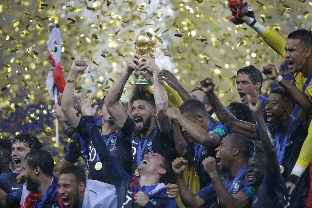 . French players celebrates with the trophy after the final match against Croatia at the 2018 soccer World Cup in the Luzhniki Stadium in Moscow, Russia, Sunday, July 15, 2018. (AP Photo/Natacha Pisarenko)