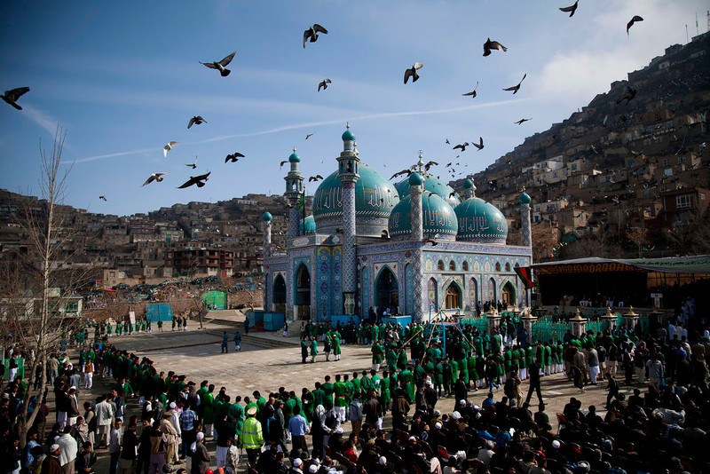 . Hundreds of Afghans wait to see the holy flag at the Kart-e Sakhi mosque in Kabul, Afghanistan, Thursday, March 21, 2013. Afghanistan celebrates Nowruz, marking the first day of spring and the beginning of the year on the Iranian calendar. (AP Photo/Anja Niedringhaus)
