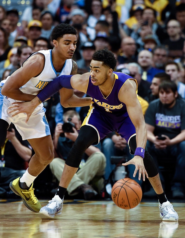 . DENVER, CO - MARCH 02: Denver Nuggets guard Gary Harris (14) guards Los Angeles Lakers guard D\'Angelo Russell (1) during the first quarter March 2, 2016 at Pepsi Center. (Photo By John Leyba/The Denver Post)