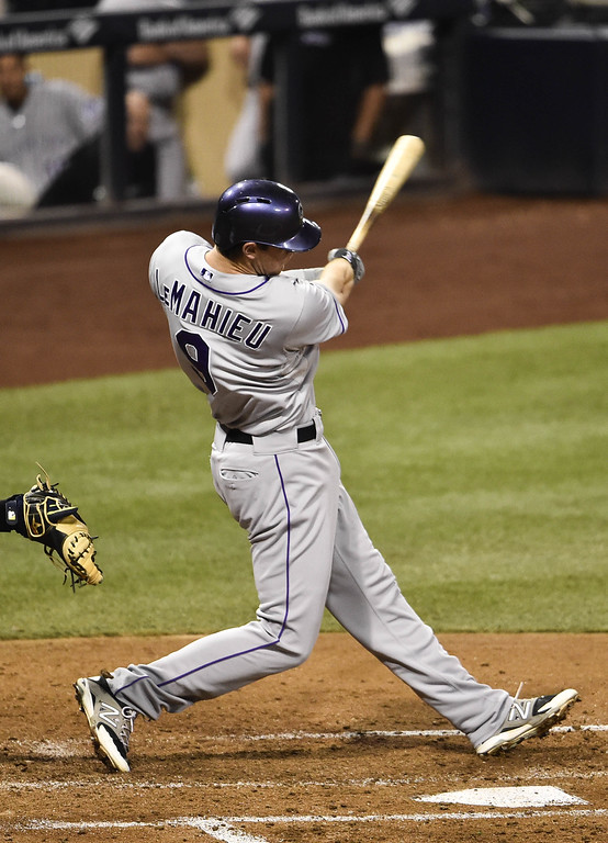 . SAN DIEGO, CA - SEPTEMBER 23:  DJ LeMahieu #9 of the Colorado Rockies hits an RBI single during the fourth inning of a baseball game against the San Diego Padres at Petco Park September, 23, 2014 in San Diego, California.  (Photo by Denis Poroy/Getty Images)