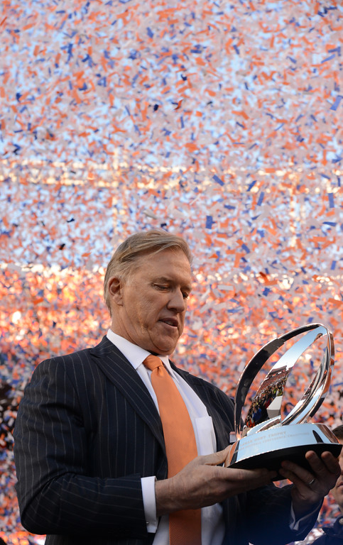 . DENVER, CO - JANUARY 19: John Elway holds the Conference Championship trophy after the game. The Denver Broncos take on the New England Patriots in the AFC Championship game at Sports Authority Field at Mile High in Denver on January 19, 2014. (Photo by John Leyba/The Denver Post)
