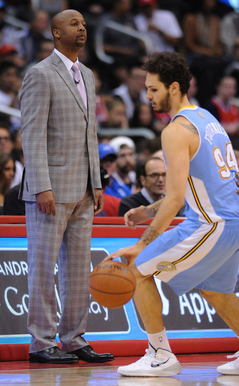 . Nuggets coach Brian Shaw takes a look a the first half action. The Los Angeles Clippers took on the Denver Nuggets in a regular season NBA game. Los Angeles, CA. 4/15/2014(Photo by John McCoy / Los Angeles Daily News)
