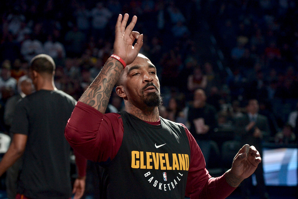 . Cleveland Cavaliers guard JR Smith gestures during player introductions before an NBA basketball game against the Memphis Grizzlies Friday, Feb. 23, 2018, in Memphis, Tenn. (AP Photo/Brandon Dill)