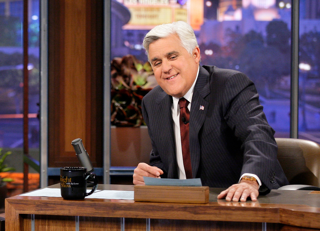 """. This Nov. 5, 2012 photo released by NBC shows Jay Leno, host of \""""The Tonight Show with Jay Leno,\"""" on the set in Burbank, Calif. As Jay Leno lobs potshots at ratings-challenged NBC in his \""""Tonight Show\"""" monologues, speculation is swirling the network is taking steps to replace the host with Jimmy Fallon next year and move the show from Burbank to New York.  NBC confirmed Wednesday, March 20, it\'s creating a new studio for Fallon in New York, where he hosts \""""Late Night.\"""" But the network did not comment on a report that the digs at its Rockefeller Plaza headquarters may become home to a transplanted, Fallon-hosted \""""Tonight Show.\""""  (AP Photo/NBC, Paul Drinkwater)"""