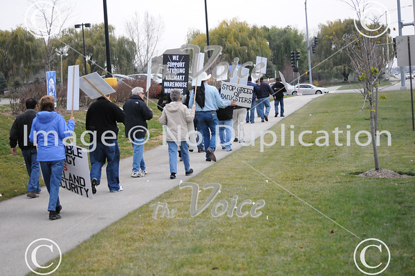 Northern Illinois Jobs with Justice rally in front of Walmart at Route 56 and Farnsworth Avenue in Aurora,  IL 11-9-12