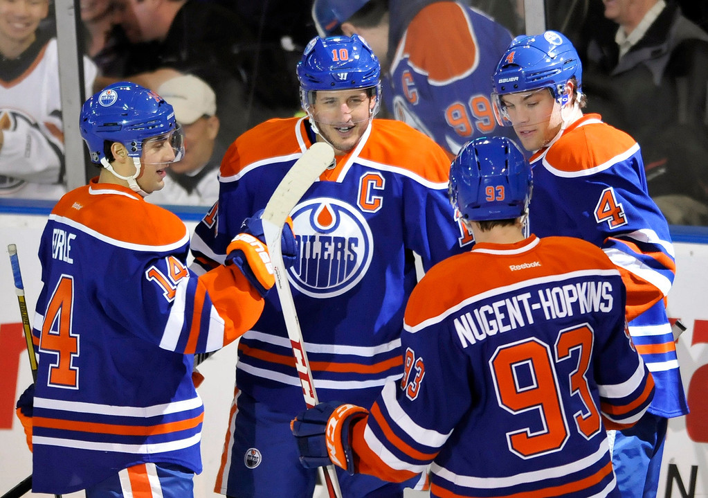 . Edmonton Oilers\' Shawn Horcoff (C) celebrates his goal with his teammates Jordan Eberle (L), Taylor Hall (R) and Ryan Nugent-Hopkins during the second period of their NHL hockey game against the Colorado Avalanche in Edmonton January 28, 2013.  REUTERS/Dan Riedlhuber