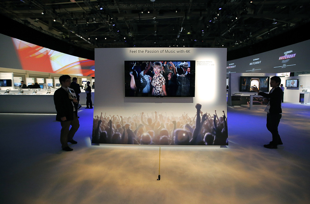 . Technicians install Sony\'s 4k Ultra HD television at the Sony booth at the International Consumer Electronics Show in Las Vegas, Monday, Jan. 7, 2013. The 2013 International CES gadget show, the biggest trade show in the Americas, is taking place in Las Vegas this week. (AP Photo/Jae C. Hong)