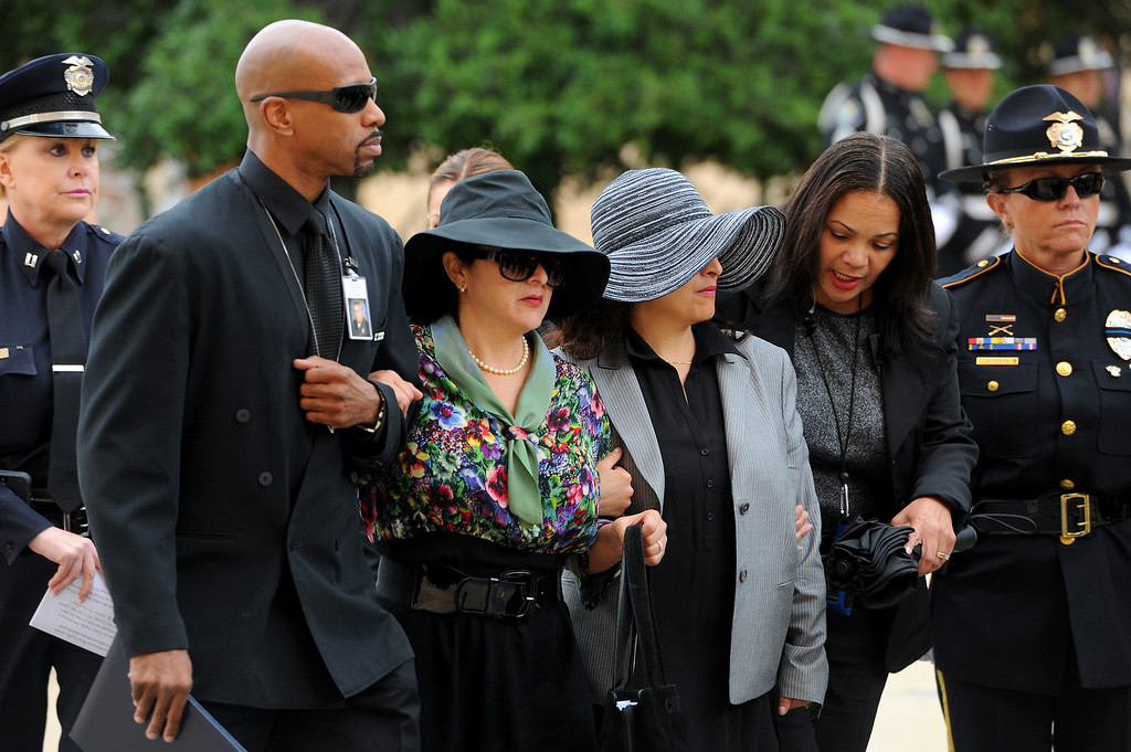 . People arrive for the funeral mass for LAPD motorcycle officer Chris Cortijo at Cathedral of Our Lady of the Angels, Tuesday, April 22, 2014. (Photo by Michael Owen Baker/L.A. Daily News)