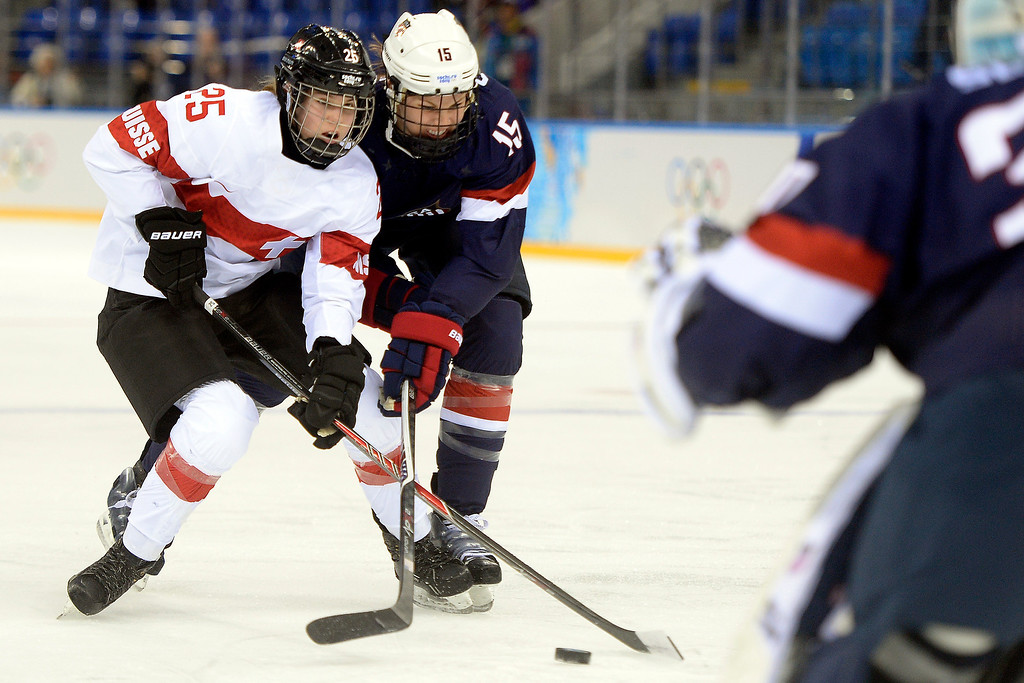 . Anne Schleper (15) of the U.S.A. breaks up a breakaway by Alina Muller (25) of the Switzerland during the first period of action at the Shayba Arena. Sochi 2014 Winter Olympics on Monday, February 10, 2014. (Photo by AAron Ontiveroz/The Denver Post)
