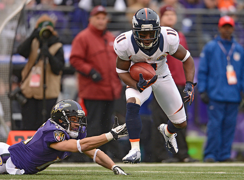 . Denver Broncos wide receiver Trindon Holliday (11) just gets past a diving Baltimore Ravens wide receiver David Reed (16) as he gains a few yards during a punt return Sunday, December 16, 2012 at M&T Bank Stadium. John Leyba, The Denver Post