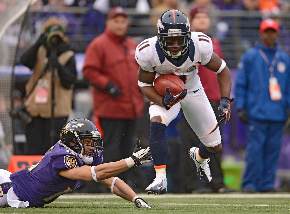 Description of . Denver Broncos wide receiver Trindon Holliday (11) just gets past a diving Baltimore Ravens wide receiver David Reed (16) as he gains a few yards during a punt return Sunday, December 16, 2012 at M&T Bank Stadium. John Leyba, The Denver Post